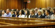 Oscar Pistorius's family sits and watches his testimony in Pretoria on April 14, 2014