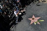 "Flowers are placed on Dick Clark's Hollywood Walk of Fame Star in Hollywood, California. Clark, who hosted ""American Bandstand"", died of a massive heart attack at age 82"