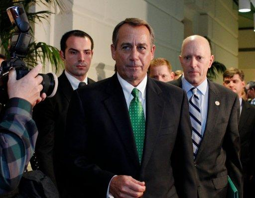 "House Speaker John Boehner walks out after a second meeting with House Republicans at the US Capitol on January 1, 2013 in Washington, DC. After fervent New Year brinkmanship, the US Congress Tuesday finally backed a deal to avert a ""fiscal cliff"" of tax hikes and slashing spending cuts that had threatened to unleash economic calamity"