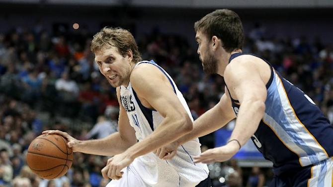 Dallas Mavericks forward Dirk Nowitzki (41), of Germany, attempts to get around Memphis Grizzlies' Marc Gasol, right, of Spain, in the second half of an NBA basketball game Saturday, Nov. 2, 2013, in Dallas. Nowitzki scored a team high 24-points in the 111-99 Mavericks win