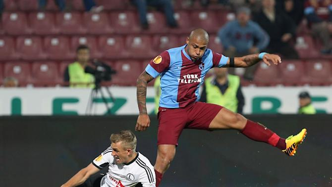 Trabzonspor's Henrique, right, and  Rzezniczak of Legia fight for the ball during their Europa League Group J soccer match in Trabzon, Turkey, Thursday, Oct. 24, 2013. (AP Photo)