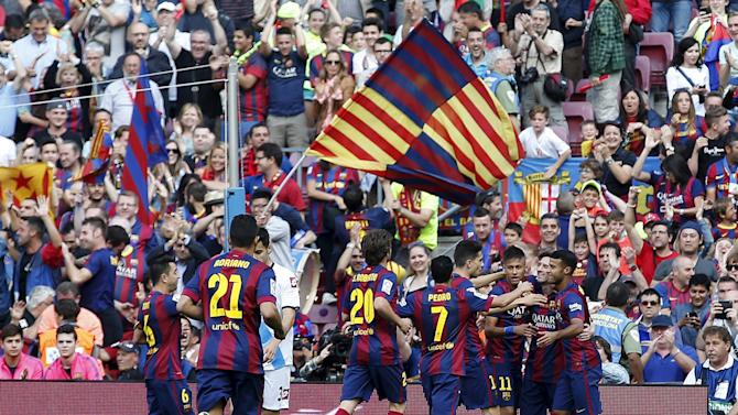 Barcelona's players celebrate Lionel Messi's goal against Deportivo La Coruna during their Spanish first division soccer match at Camp Nou stadium in Barcelona, Spain