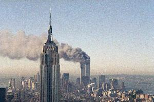 FILE - In this Sept. 11, 2001, file photo, the twin towers of the World Trade Center burn behind the Empire State Building in New York. The Sept. 11, 2001 terrorist attack is by far the most memorable moment shared by television viewers during the past 50 years, a study released on Wednesday, July 11, 2012, concluded. (AP Photo/Marty Lederhandler, File)