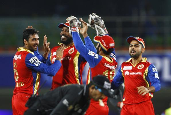 Ranchi: Royal Challengers Bangalore celebrate fall of a wicket during the second qualifier match of IPL 2015 between Chennai Super Kings and Royal Challengers Bangalore at JSCA International Cricket S