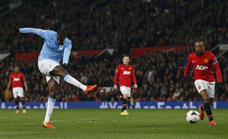 Manchester City's Toure scores against Manchester United during their English Premier League soccer match in Manchester
