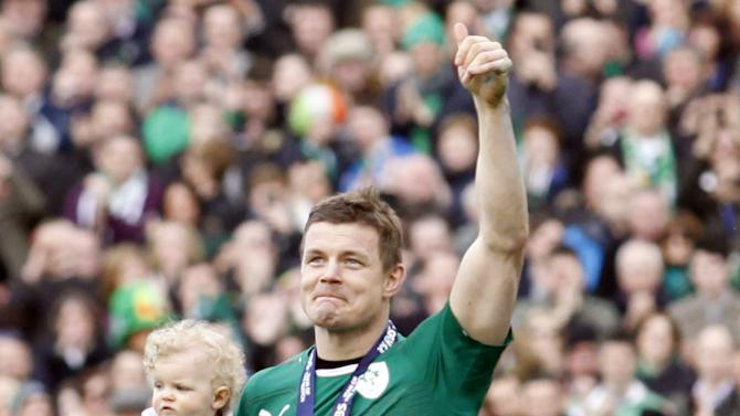 Ireland's Brian O'Driscoll and daughter Sadie leave the pitch after he played his last home game during during their Six Nations Rugby Union match against Italy at the Aviva Stadium, Dublin, Ireland, Saturday, March 8, 2014. (AP Photo/Peter Morrison)