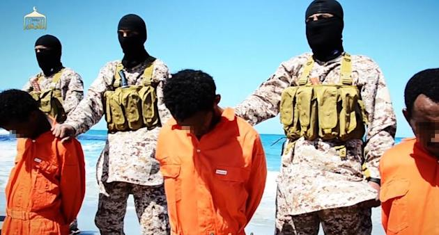 Image grab taken on April 19, 2015 from a video reportedly released by the Islamic State group purportedly shows men described as Ethiopian Christians captured in Libya kneeling in front of masked militants before their beheading on a beach in Libya