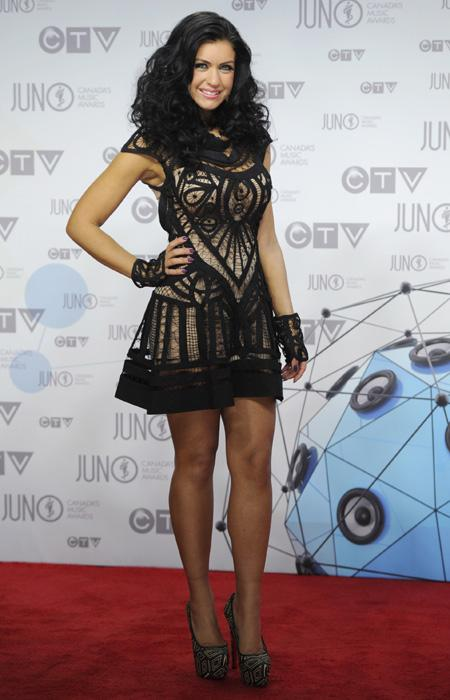 """Stereo Love"" singer Mia Martina is a gothic goddess in this black and nude lace dress with killer high heels.  We love the delicate webbing and the cute wrist gloves. THE CANADIAN PRESS/Sean Kilpatri"