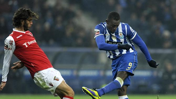 FC Porto's Jackson Martinez, from Colombia, scores the opening goal past Sporting Braga's Nuno Andre Coelho, left, in a Portuguese League soccer match at the Dragao Stadium in Porto, Portugal, Saturday, Dec. 7, 2013