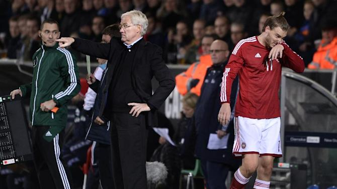 Denmark's coach Morten Olsen, center, instructs his players as Nicklas Bendtner, right, walks past during their international friendly match against Norway in Herning, Denmark, Friday, Nov. 15. 2013