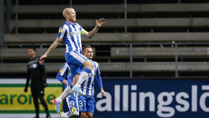 Esbjerg's Hans Henrik Andreasen, top, celebrates scoring against Elfsborg with teammates Jakob Ankersen, partly seen, and Peter Ankersen, right, during the group C Europa League match at the Boras Arena in Boras, Sweden, Thursday Oct. 24, 2013