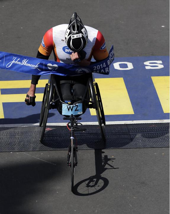 Ernst Van Dyk, of South Africa, breaks the tape to win the men's wheelchair division of the 118th Boston Marathon Monday, April 21, 2014 in Boston