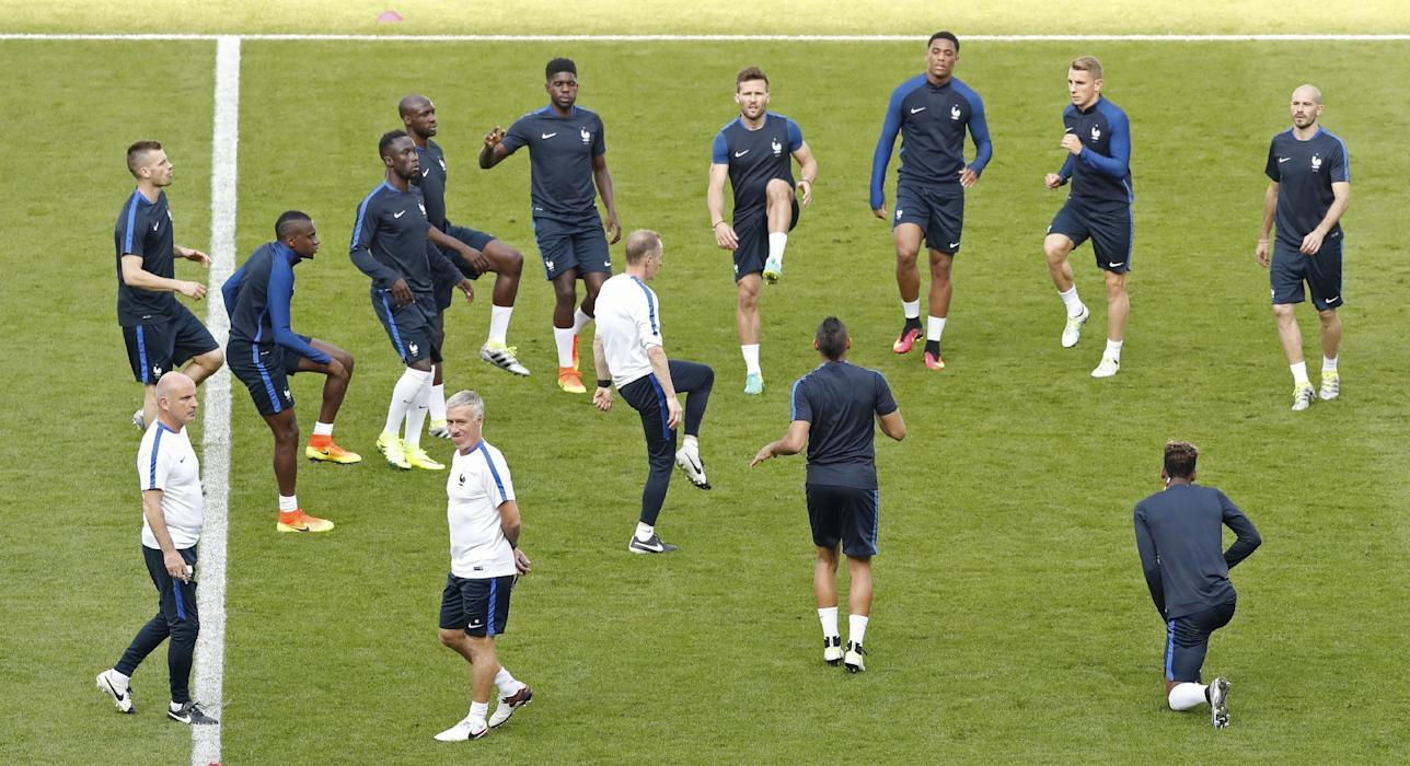 France head coach Didier Deschamps (4th L) during training