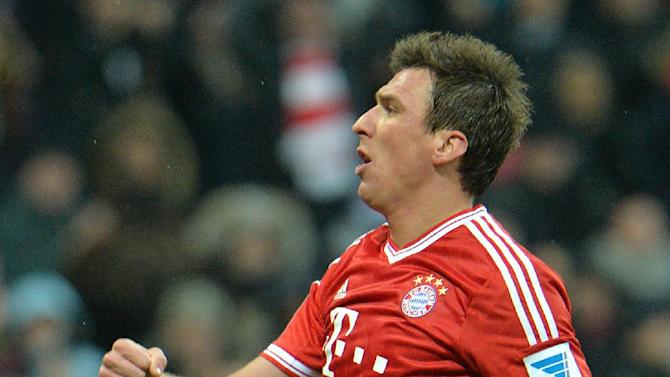 Bayern's Mario Mandzukic of Croatia celebrates after scoring during  the German first division Bundesliga soccer match between FC Bayern Munich and Hamburger SV  in Munich, Germany, Saturday, Dec. 14, 2013