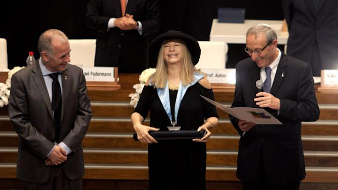 Entertainment star Barbra Streisand recives an honorary doctorate during a ceremony at the Hebrew University in Jerusalem, Monday, June 17, 2013. Streisand waded into one of Israel's touchiest issues Monday on the first major stop of her tour of the country Jewish religious practices that separate men and women. (AP Photo/Dan Balilty)