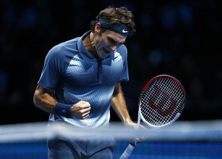 Roger Federer of Switzerland celebrates winning a point during his men's singles tennis match against Juan Martin Del Potro of Argentina at the ATP World Tour Finals at the O2 Arena in London November 9, 2013. REUTERS/Eddie Keogh