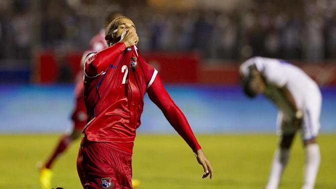 Panama's Roberto Chen kisses his jersey after scoring against Honduras at a 2014 World Cup qualifier soccer match in Tegucigalpa, Honduras, Tuesday, Sept. 10, 2013. The match ended in a 2-2 draw