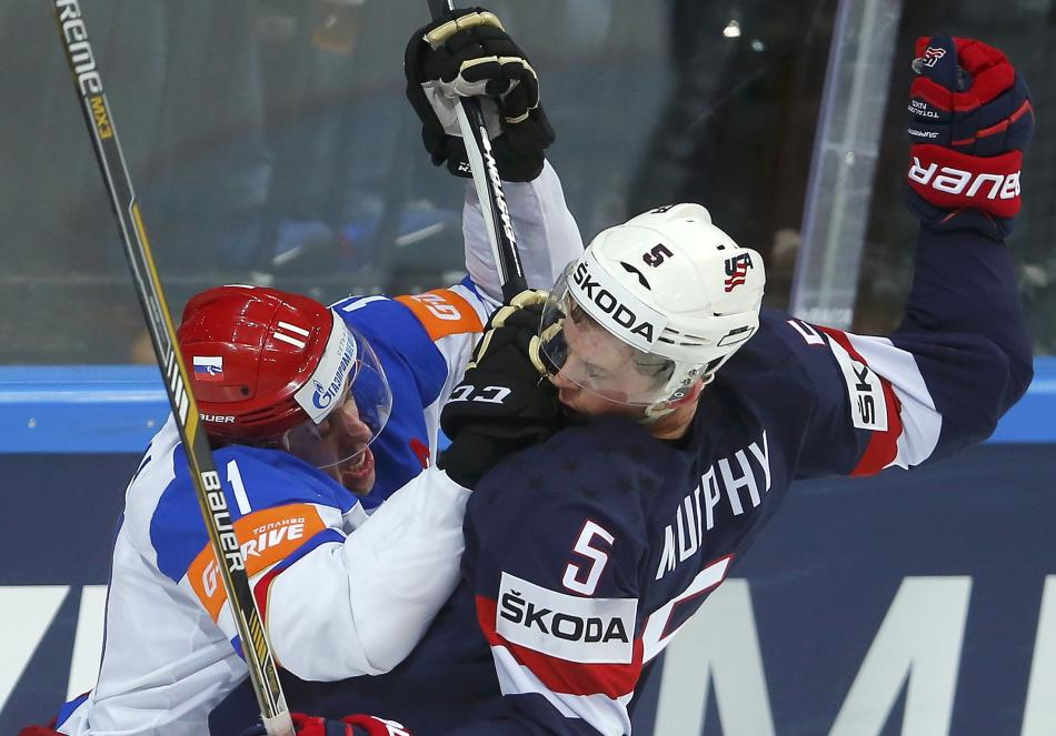 Russia's Malkin scuffles with Murphy of the U.S. during their Ice Hockey World Championship semifinal game at the O2 arena in Prague
