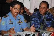 Indonesian National Search and Rescue Agency chief Vice Marshal Daryatmo (L) speaks during a press conference about the ill-fated Russian Sukhoi Superjet 100 that went missing as Sunaryo (R), a representative of the Sukhoi looks on, at the arrival area of Halim airport in Jakarta
