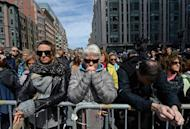 People observe a moment of silence near the Boston Marathon finish line on one week anniversary of the bombings on April 22, 2013
