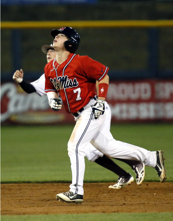 Mississippi's Dalton Dulin (7) watches a fifth-inning pop foul by teammate Braxton Lee against Mississippi State in an NCAA college baseball game in Pearl, Miss., Tuesday, April 22, 2014. (AP Phot