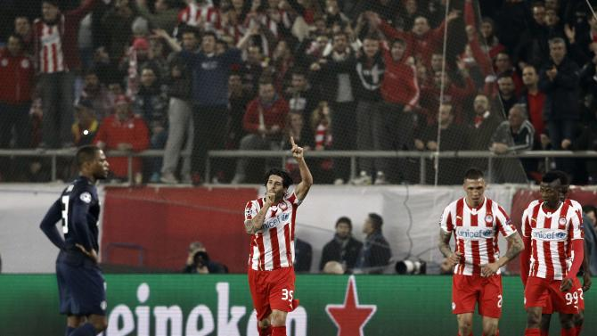 Olympiakos' Dominguez celebrates after scoring against Manchester United during their Champions League round of 16 first leg soccer match in Piraeus