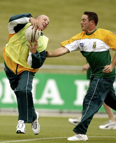 14 Jan 2002:  Boeta Dippenaar avoids Mark Boucher in a game of touch rugby, during South Africa Training at Bellerive Oval, Hobart, Australia. DIGITAL IMAGE. Mandatory Credit: Hamish Blair/Getty Images