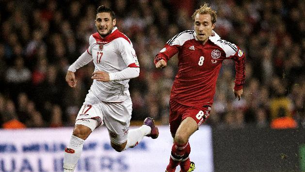 Malta's Ryan Fenech, left, and Denmark's Christian Eriksen, right, vie for the ball during their  Group B 2014 FIFA World Cup qualifying soccer match played in Parken, Copenhagen on Tuesday, Oct 15, 2013