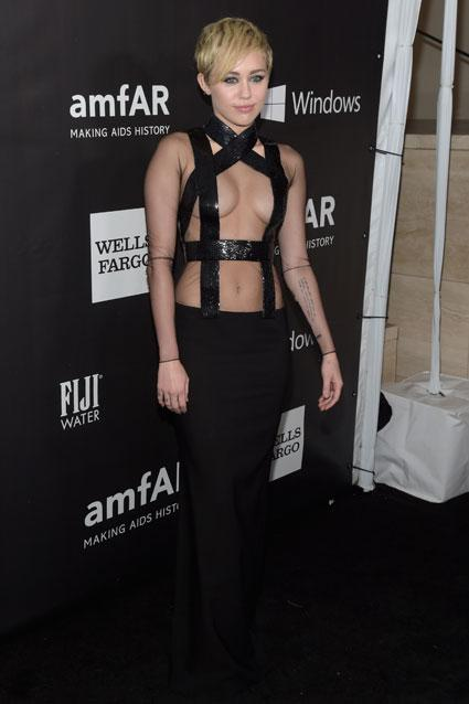 Miley Cyrus and Rihanna Bid For Best Cleavage at amfAR Gala