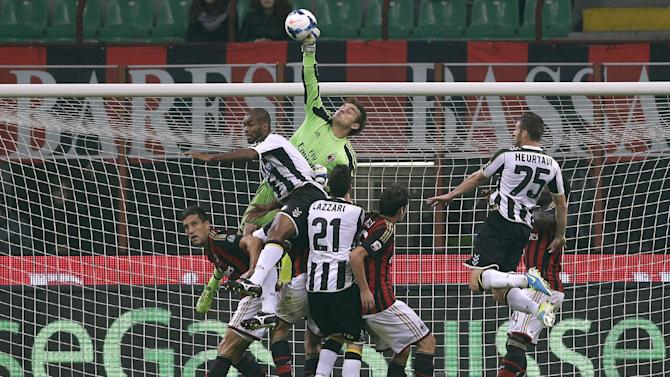 AC Milan goalkeeper Gabriel Ferreira reaches for the ball during a Serie A soccer match between AC Milan and Udinese, at the San Siro stadium in Milan, Italy, Saturday, Oct. 19, 2013