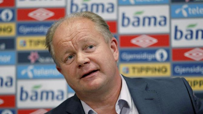 Sweden's Per-Mathias Hogmo, newly appointed head coach for Norway's national football team, answers questions at a press conference in Oslo, Friday, Sept.  27, 2013.  Hogmo has been tapped as Norway's new coach, immediately replacing Egil Olsen who agreed to resign after the latest poor results in the team's attempt to qualify for the World Cup
