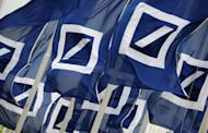 Flags with the logo of German bank Deutsche Bank flutter in the wind in Frankfurt. Deutsche Bank wants to cooperate with European investigators probing the manipulation of interbank interest rates to limit damage to its reputation and bottom line, a newspaper said Sunday