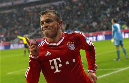 Bayern Munich's Shaqiri celebrates goal against Hamburger SV during German Bundesliga match in Munich