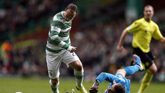 Celtic's Griffiths is challenged by St Mirren's Kello during their Scottish Premier League soccer match at Celtic Park Stadium in Glasgow