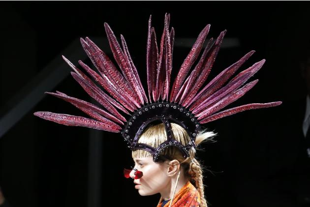 A model presents a creation by Indian designer Manish Arora as part of his Autumn/Winter 2015/2016 women's ready-to-wear collection during Paris Fashion Week
