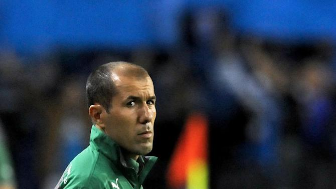 Sporting's coach Leonardo Jardim stands on the touch line prior to their 3-1 defeat against FC Porto in a Portuguese League soccer match at the Dragao stadium in Porto, Portugal, Sunday, Oct. 27, 2013. Porto stands top of the league ahead of Lisbon rivals Benfica and Sporting