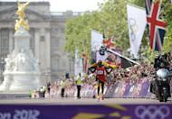 Uganda's Stephen Kiprotich seconds before crossing the finish line to win the Olympic marathon in London on August 12. Kiprotich stunned a strong Kenyan team to win the men's Olympic marathon on Sunday, handing his east African nation only their second ever gold medal