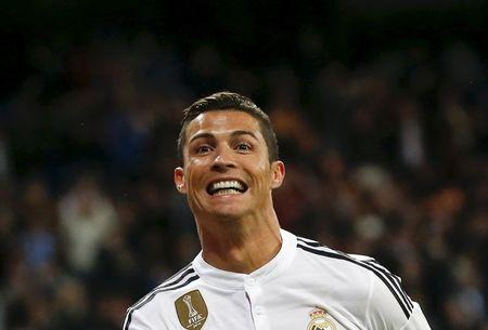 Real Madrid's Cristiano Ronaldo celebrates his goal against Malaga during their Spanish First Division soccer match at Santiago Bernabeu stadium in Madrid