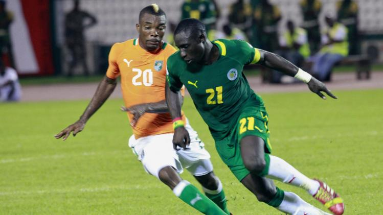 Ivory Coast's Serey Die Geoffroy fights for the ball with Senegal's Pape Mohamed Diame during their 2014 World Cup qualifying soccer match in Abidjan