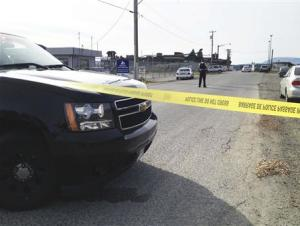 A Royal Canadian Mounted Police (RCMP) officer stands watch at the scene of a morning shooting at the Western Forest Products mill on Vancouver Island in Nanaimo