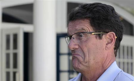 Russia's national soccer team coach Fabio Capello talks with journalists at the Costa do Sauipe resort in Sao Joao da Mata, Bahia state, December 5, 2013. REUTERS/Sergio Moraes/Files