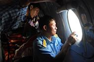 A plane looks for missing Malaysia Airlines flight MH370 off Vietnam on March 9, 2014