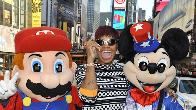 **EXCLUSIVE** Singer Fantasia hangs out with Mickey Mouse and Super Mario in New Yorks Time Square