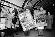 People carry paintings in the London Underground as a cleaning woman looks on in 1946. The London Underground began celebrating its 150th birthday on Wednesday, creaking under the demand of four million daily passengers as it looked back to the opening of the world's first underground railway in 1863