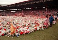 Thousands of wreaths are displayed at Anfield stadium April 20, 1989 in memory of the 96 fans who died after support railings collapsed during a match between Liverpool and Nottingham Forest. The Hillsborough Independent Panel report found that senior police officers had mounted a concerted campaign to cover up their errors in the worst disaster in British football history.