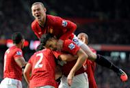 Manchester United's Wayne Rooney (up) celebrates after Robin van Persie (C) scored at Old Trafford in Manchester on November 3, 2012. Alex Ferguson has warned Manchester United's title rivals that revitalised Mexico striker Javier Hernandez will play a significant role in the battle for the Premier League
