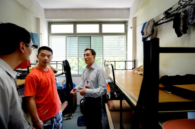 SMRT chief Desmond Kuek pays a visit to the Serangoon bus driver dorm.