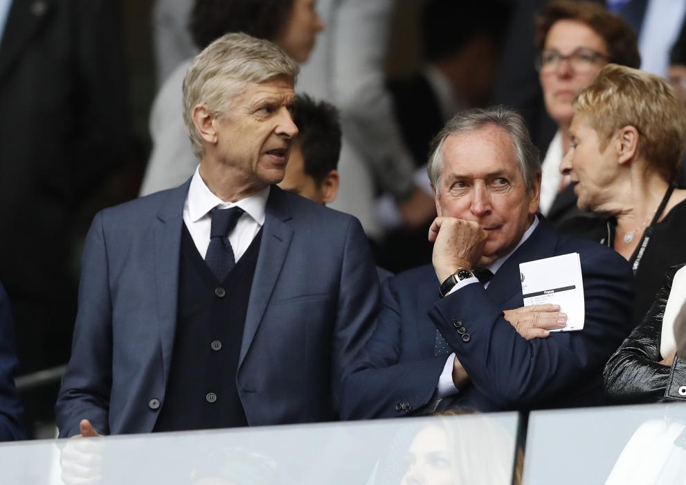 Arsenal manager Arsene Wenger and Gerard Houllier in the stands
