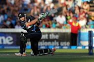 New Zealand's Martin Guptill hits a shot during their second Twenty20 international against England in Hamilton on February 12, 2013. Guptill (47) and Hamish Rutherford (40) provided a solid platform for skipper Brandon McCullum to blast away late in the innings in a display that included three sixes off a Stuart Broad over