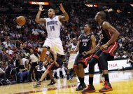 Orlando Magic's Jameer Nelson (14) loses control of the ball as Miami Heat's Mario Chalmers (15) and James Jones (22) look on during the first half of an NBA basketball game, Sunday, March 18, 2012, in Miami. (AP Photo/Lynne Sladky)